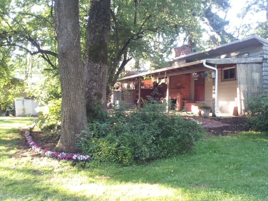 Back patio. Notice the brick fireplace under the cover.
