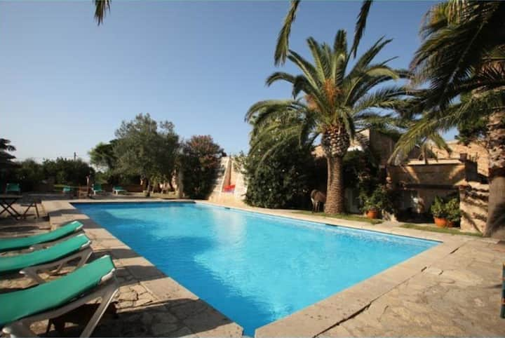 Stunning Apartment Can Caragol with Mountain View, Pool, Terrace & Garden; Parking Available, Pets Allowed