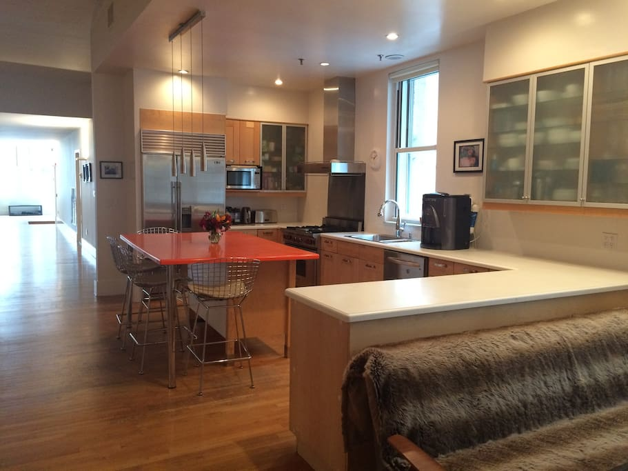 Fabulous chef's kitchen with Wolf gas oven, Subzero fridge/freezer, dishwasher - while your guests can sit & chat, or children can play safely.