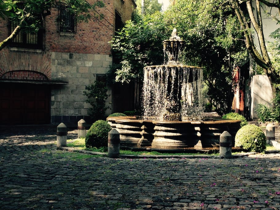Fountain half block from house. See cobble stone streets.