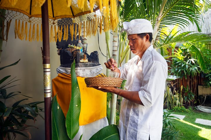 Made, the housekeeper, giving offerings at the house temple