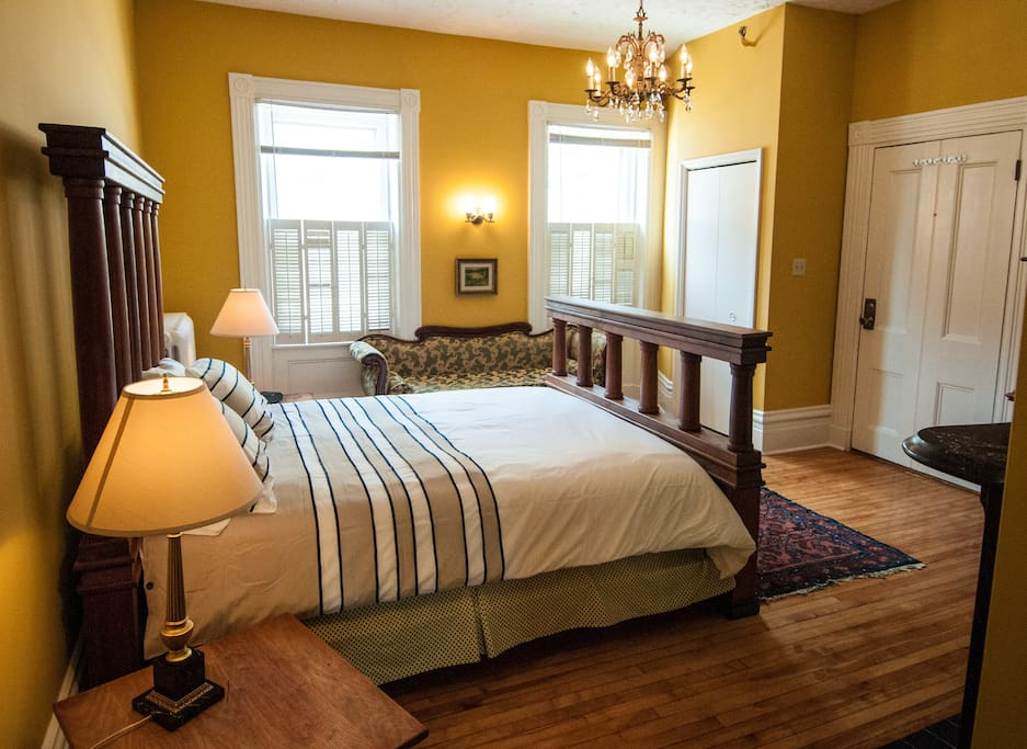 The bedroom with the original hardwood floors.