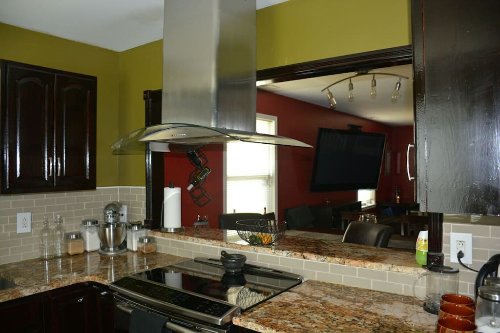 Kitchen has a bar countertop which opens up to the dinning room.