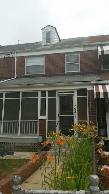 Front of home with cozy enclosed porch!