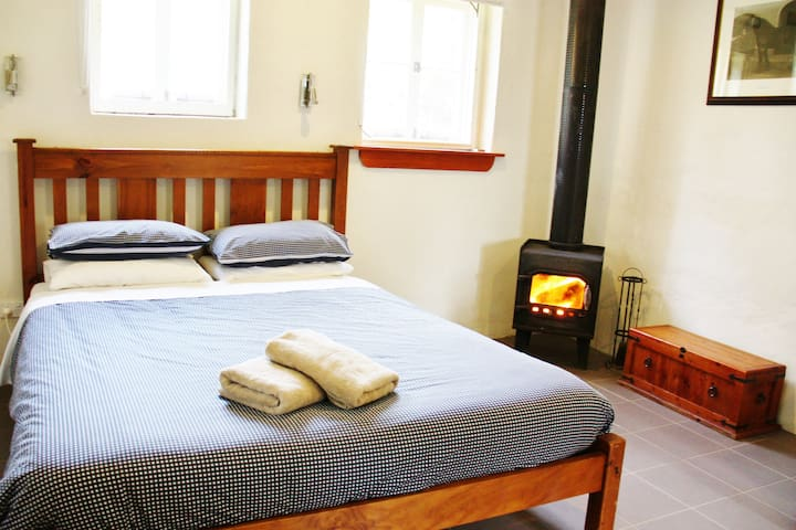 The Stallion Box is a queen bedroom suite, with both reverse cycle air conditioning and wood fire.
