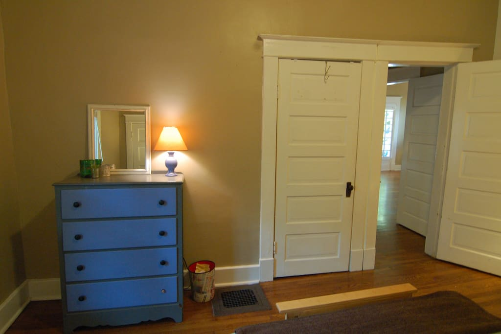 A dresser and closet are available for storage.