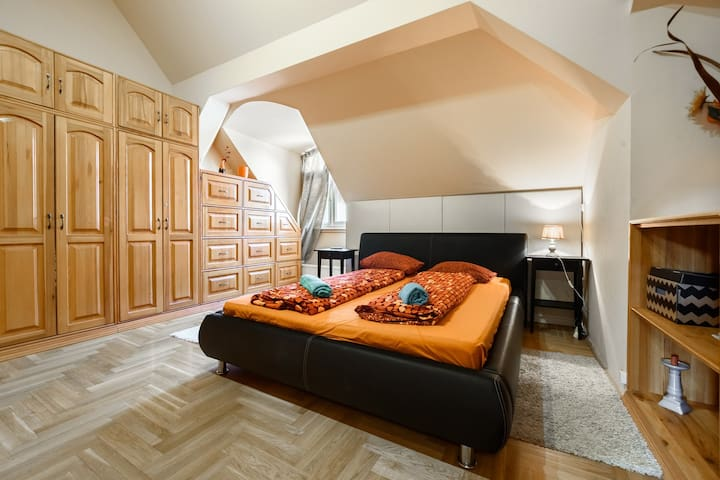 The bedding in the king size double bed in bedroom 2