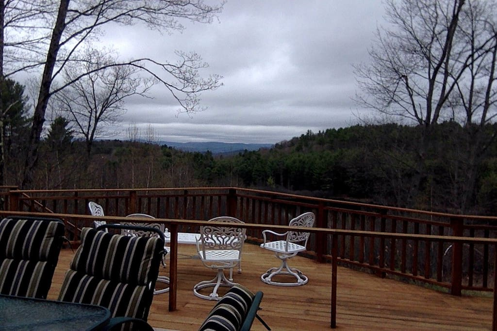 Mountain views over large pond off large deck.
