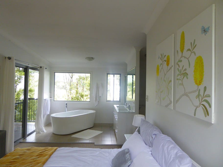 Master bedroom with new paintings of banksias.
