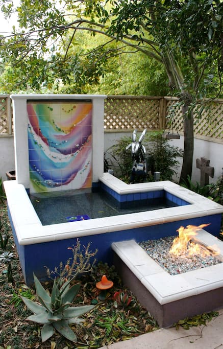 Or enjoy the artistic backyard, while sitting by the fire pit.