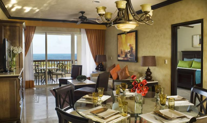 Dining room, living room, and deck