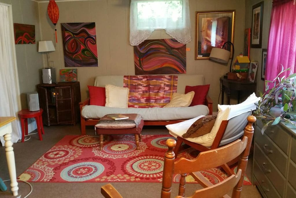 Artsy and comfortable with lots of light.  Queen futon adds extra sleeping space.