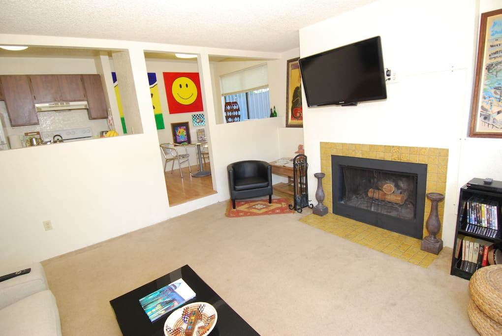 HD TV, chromecast , DVD player, a small selection of movies, books, and wood burning fireplace.