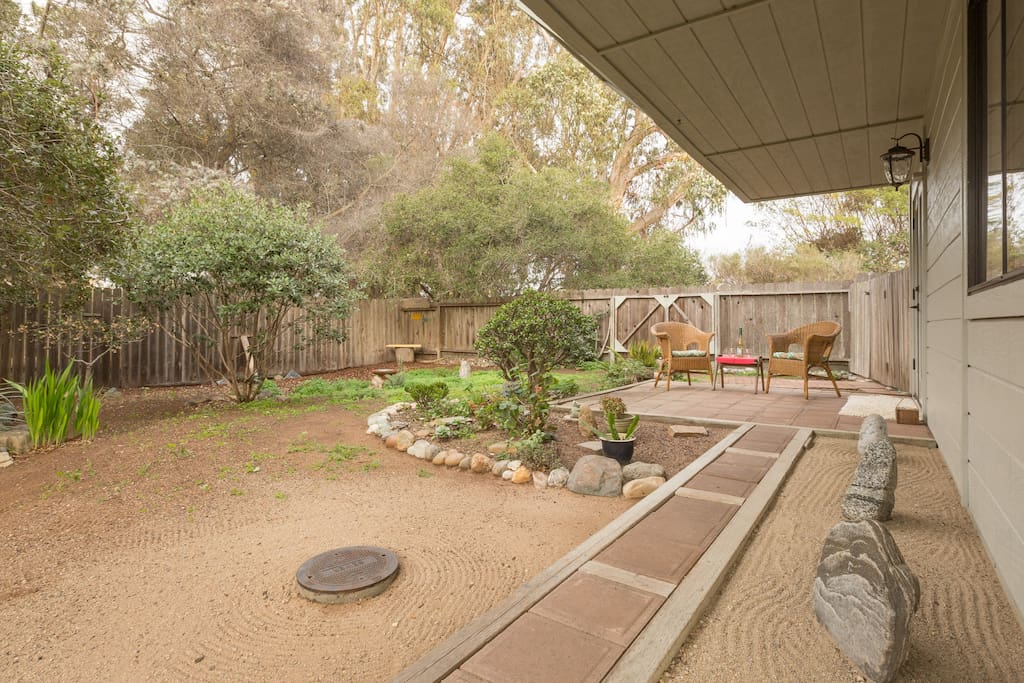 Zen garden path to private patio & french door entrance