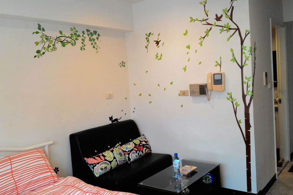 Bed and sofa and tree wall