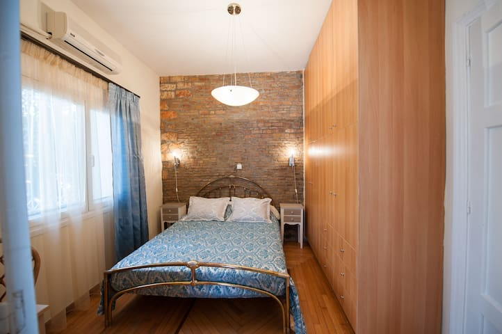Master bedroom - Enjoy a good nights sleep, in rich cotton bed sheets, and an antique bed frame