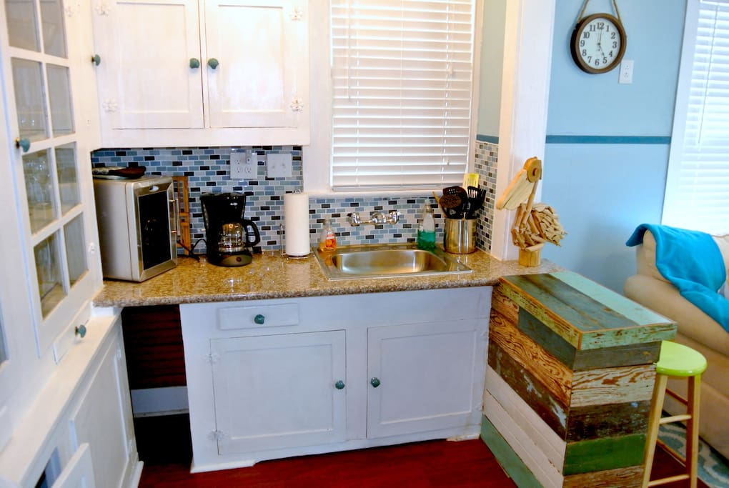 Granite counter tops and original 1910 built-in cabinetry.