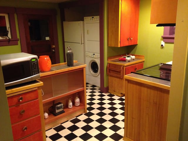 Kitchen with dining nook. Washer dryer in unit