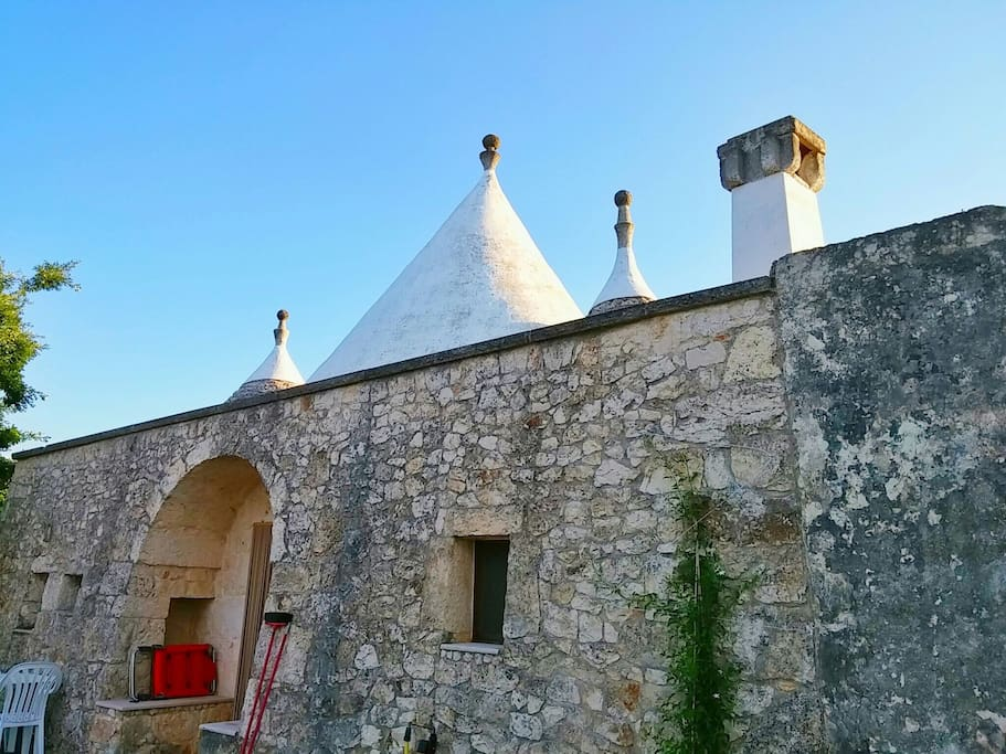 Facade of the trullo complex on a beautiful summer day