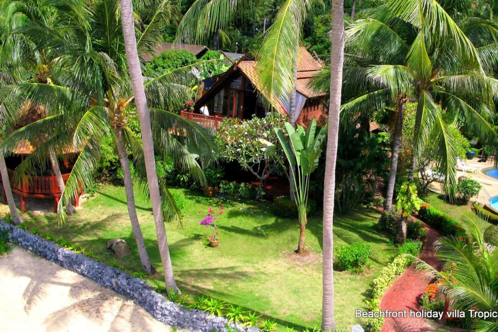 The holiday villa is positioned on a large, private beach front plot.