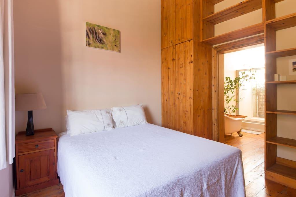 The bedroom has a comfortable queen size bed and en suite bathroom.