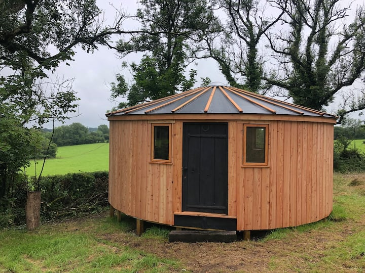 Unique timber yurt, stunning views and use of pool