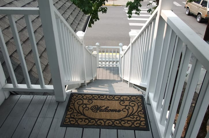 Guest private lighted stairwell Entry Door and Balcony. The entire second floor is for the Guests, 2 BR, Small FR, kitchenette, sm. refrigerator and microwave and bathroom. All in the midst of downtown Jacksonville, OR.