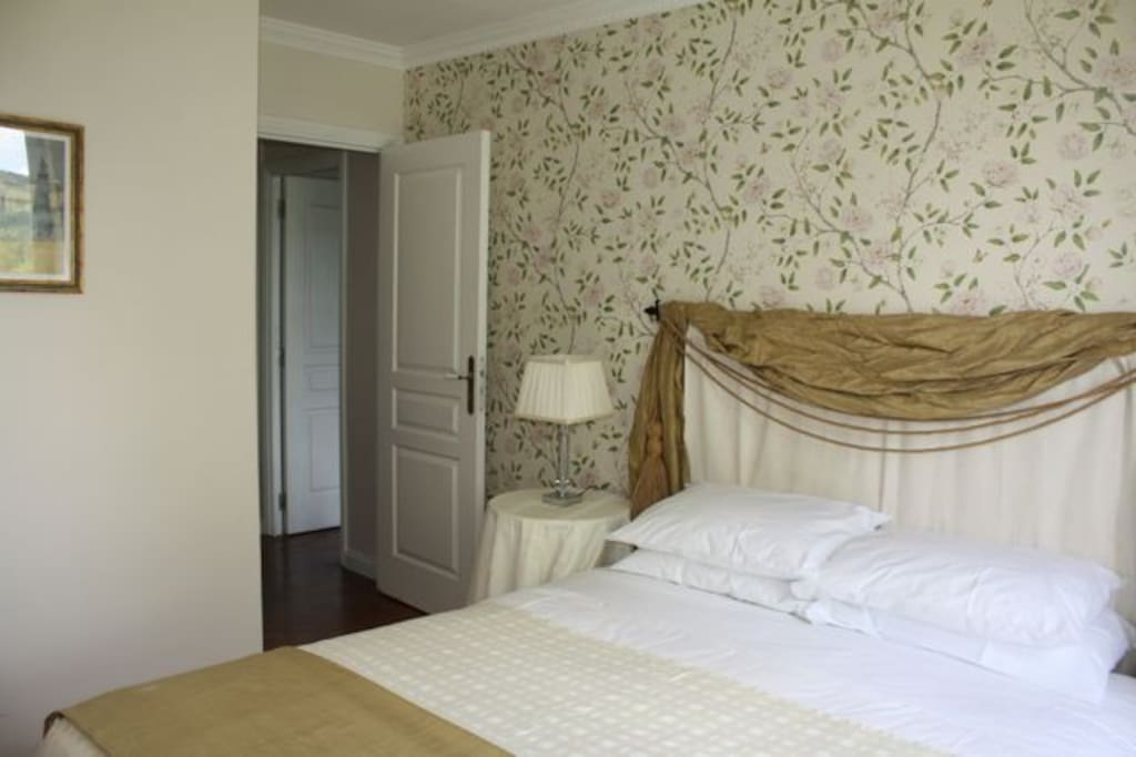 The Queen-sized bed in room 1 of the Walnut Suite