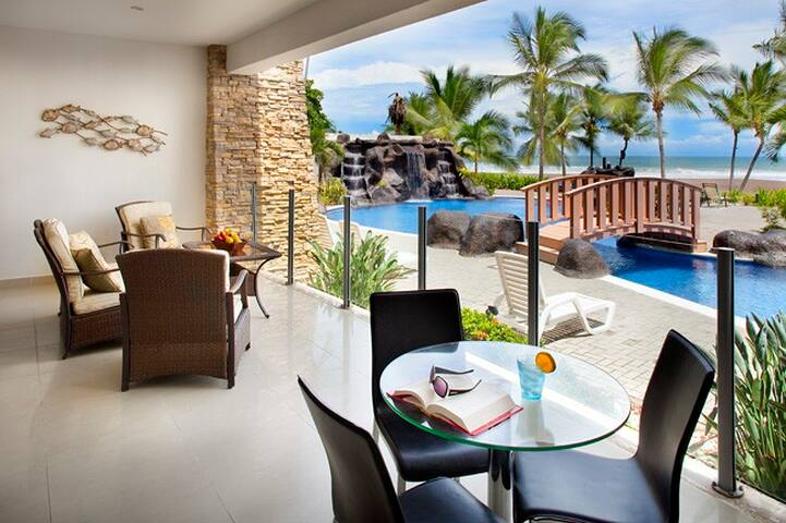 Ocean front terrace right in front of the pool