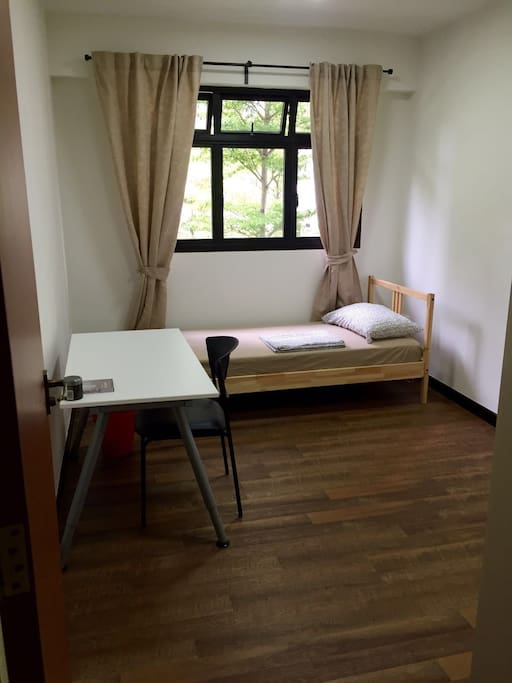 Cosy private room with study table, bed, pillow & wardrobe