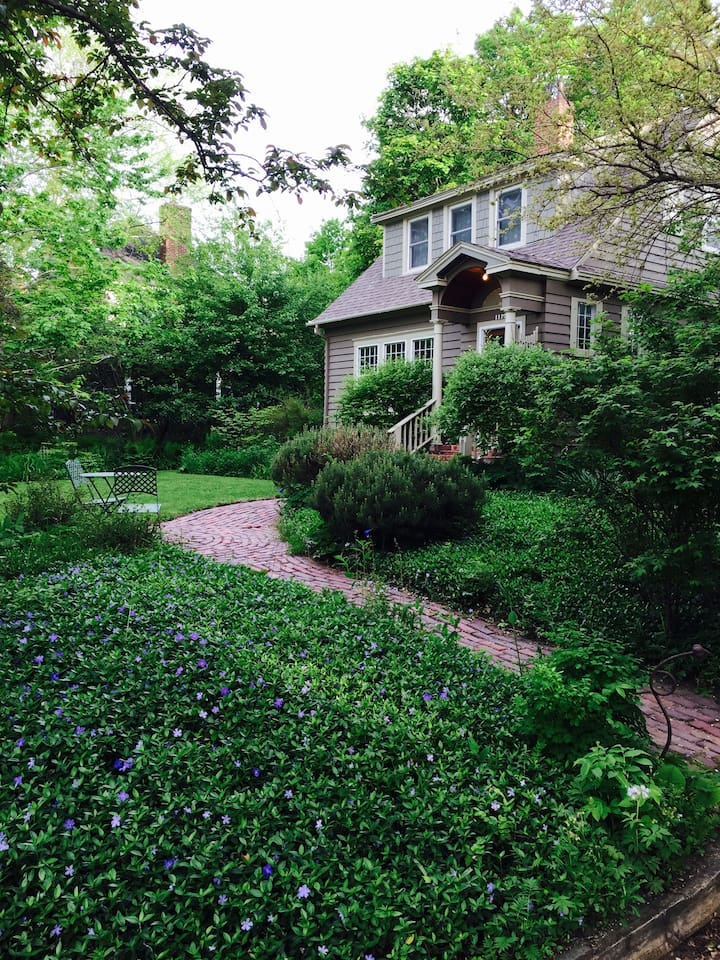 Summer- perennial beds surround house