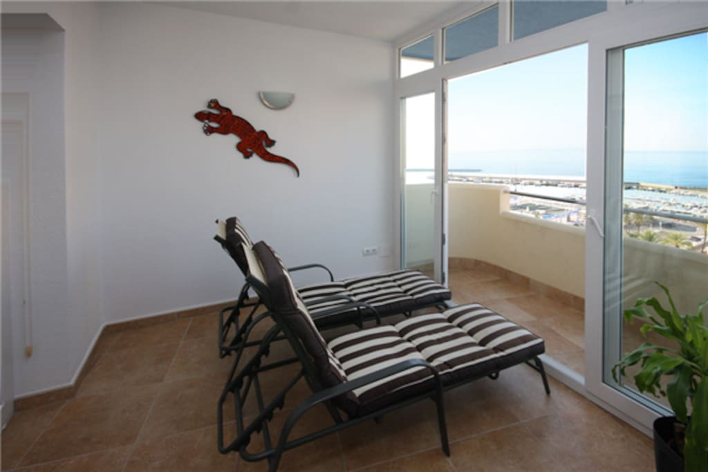 Terrace area with two sunbeds for relaxing
