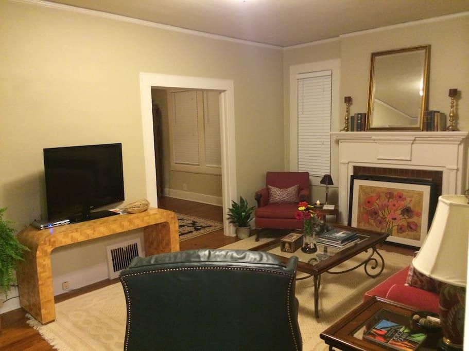 Livingroom, 9 foot ceilings, hardwood floors, comfortably furnished.