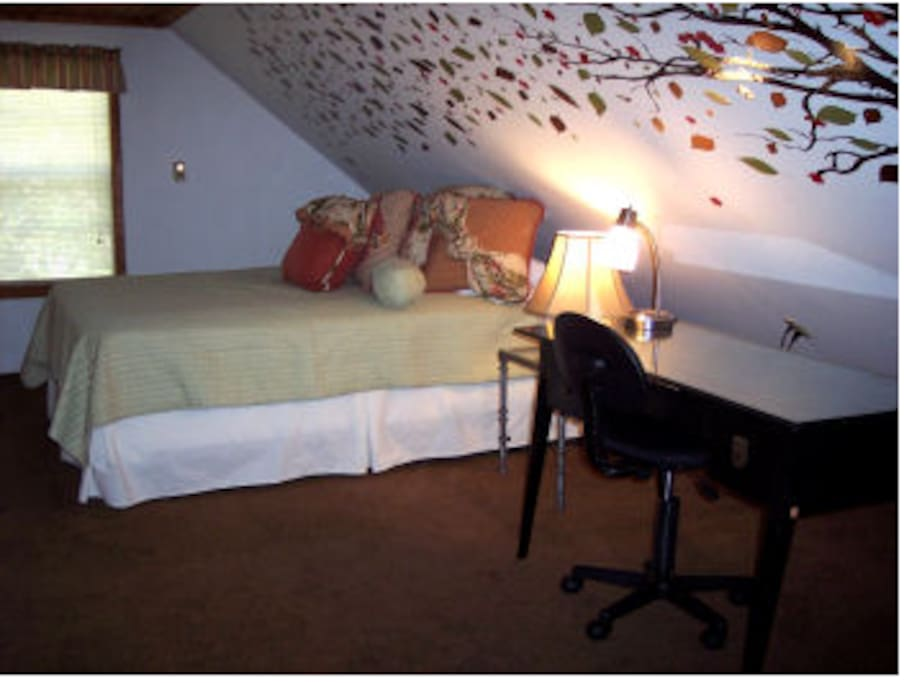 This is the loft, where leaves blow across your bed and out the window, just like your worries while you're at the cozy cottage.