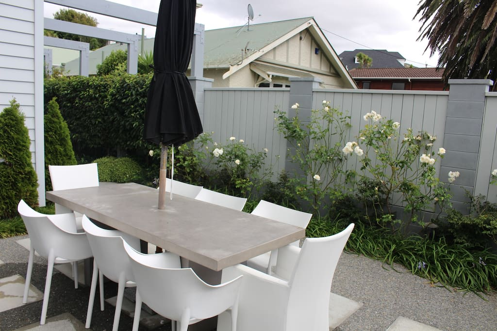 Umbrella-covered outdoor dining, seats 8