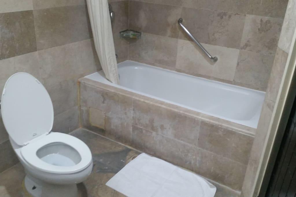 Spacious bathroom with tub