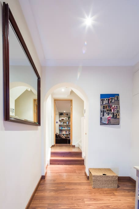 Step into the entrance hall, with the family room in front of you.