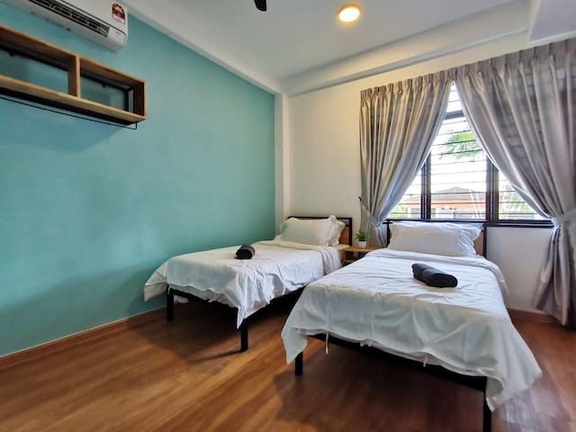 Interior View of Room 1: 1 Queen Bed & 2 Single Beds