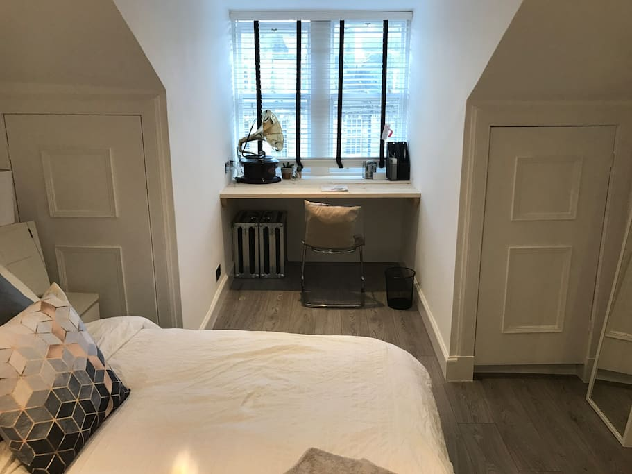 This is the office/desk space in the bedroom. The cupboards are available to store your belongings too. You can see the castle/fireworks at the tattoo from here.