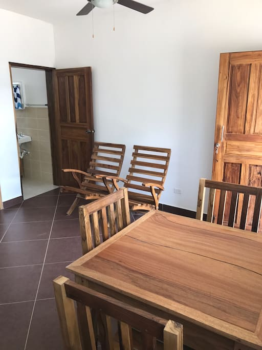 Wooden dining table with seating for four. Two extra chairs for relaxing as well.