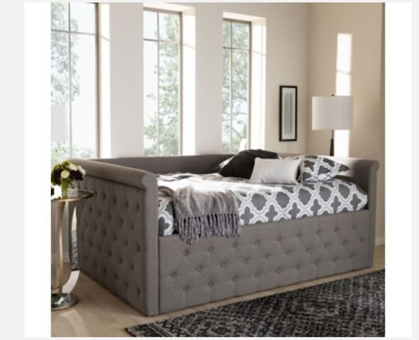 Queen size daybed doubles as couch. Who likes to take a nap while watching Sunday Golf?