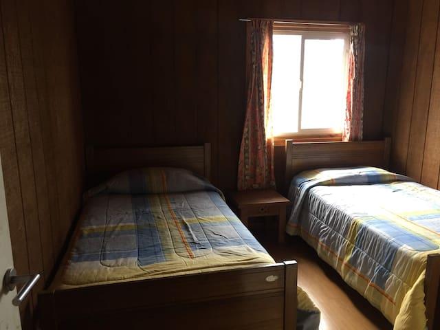 Hogar acogedor, dos camas , linda vista