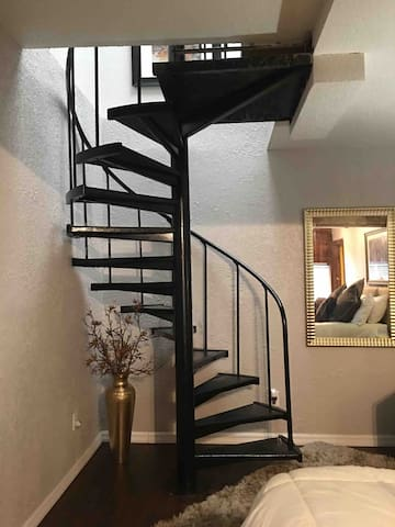 Spiral staircase top level living room kitchen and bath..  Lower level large  bedroom with king bed