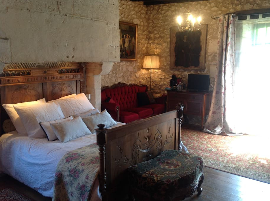 One of the delightful   suites. This one has bath and sep. shower. All bedrooms have ample seating / lounging space.