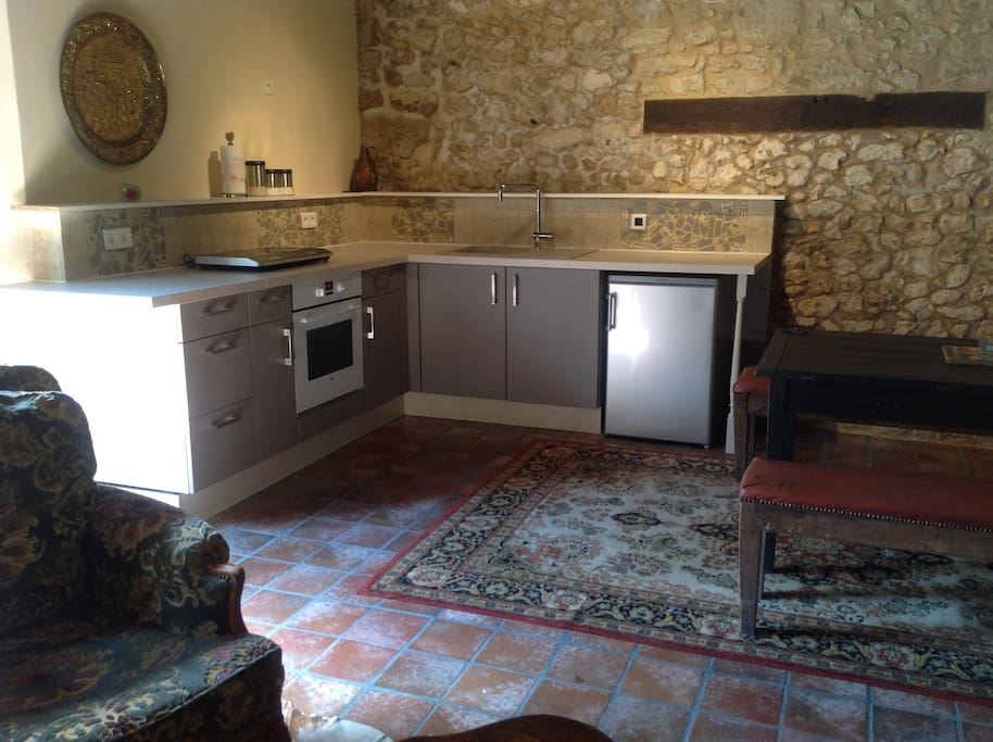 Beautiful  fully equipped kitchen with direct access to the covered pool terrace.