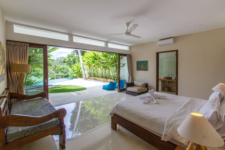 The master bedroom downstairs is luxe and spacious. The view from bed in the morning is amazing!