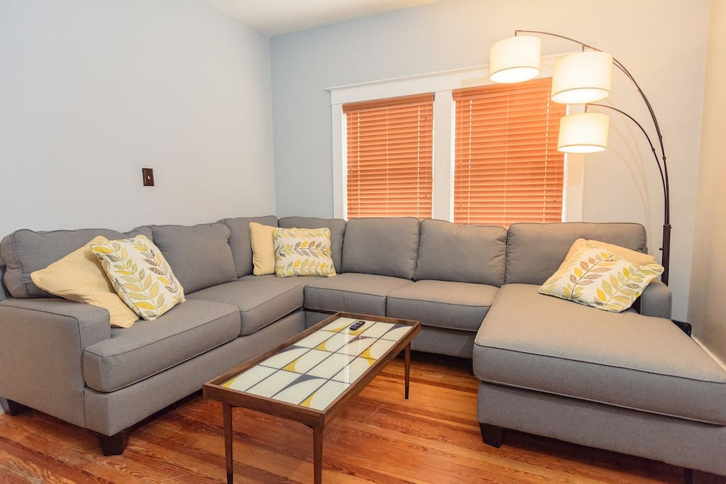 Everyone has a seat on our large sectional in the first floor living room!
