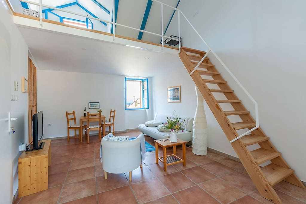 The 2-levels loft, very bright, spacious and airy, with fantastic views of Komiža's rooftops and the open sea on one side and mountains on the other.