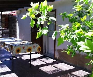 Monolocale con veranda nel verde - alghero
