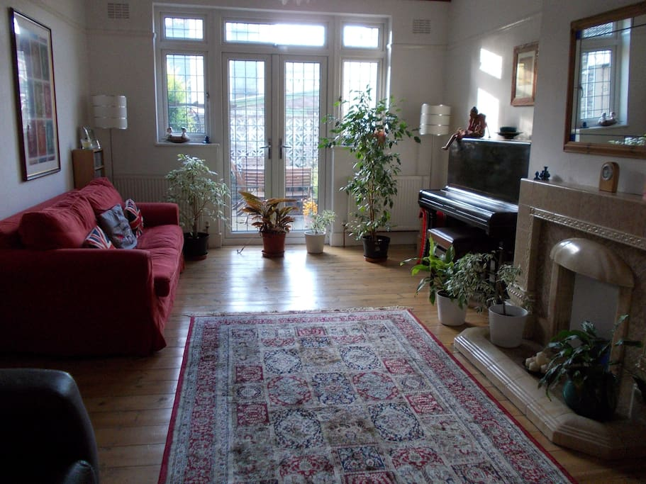 Shared living room, french doors leading to garden.